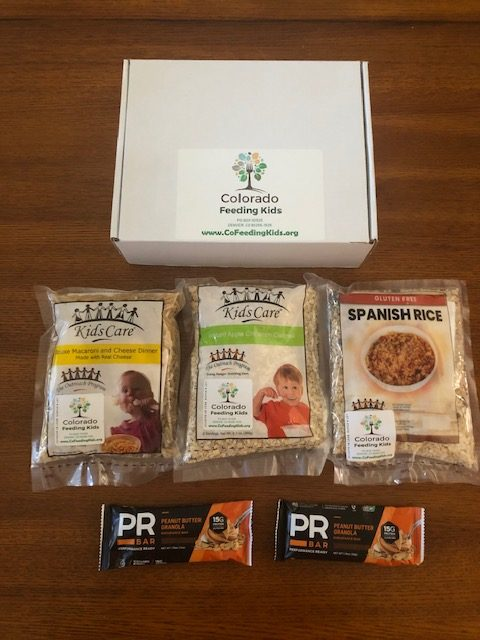 Meal Pack that consists of a white box, three bags of grains and two powerbars