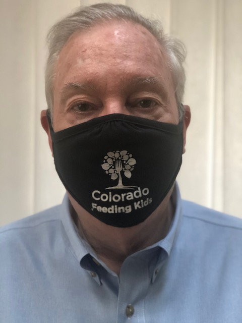 president of Colorado Feeding Kids wearing a branded face mask